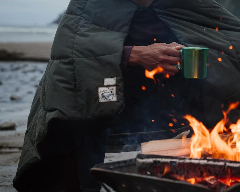 Snow Peak & Rumpl Create Fire-Resistant Camp Blanket at werd.com