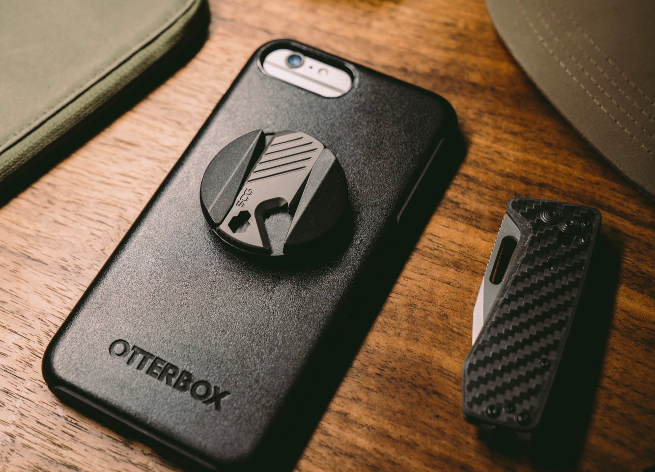 SOG PopGrip Adds a Multitool to Your Phone at werd.com